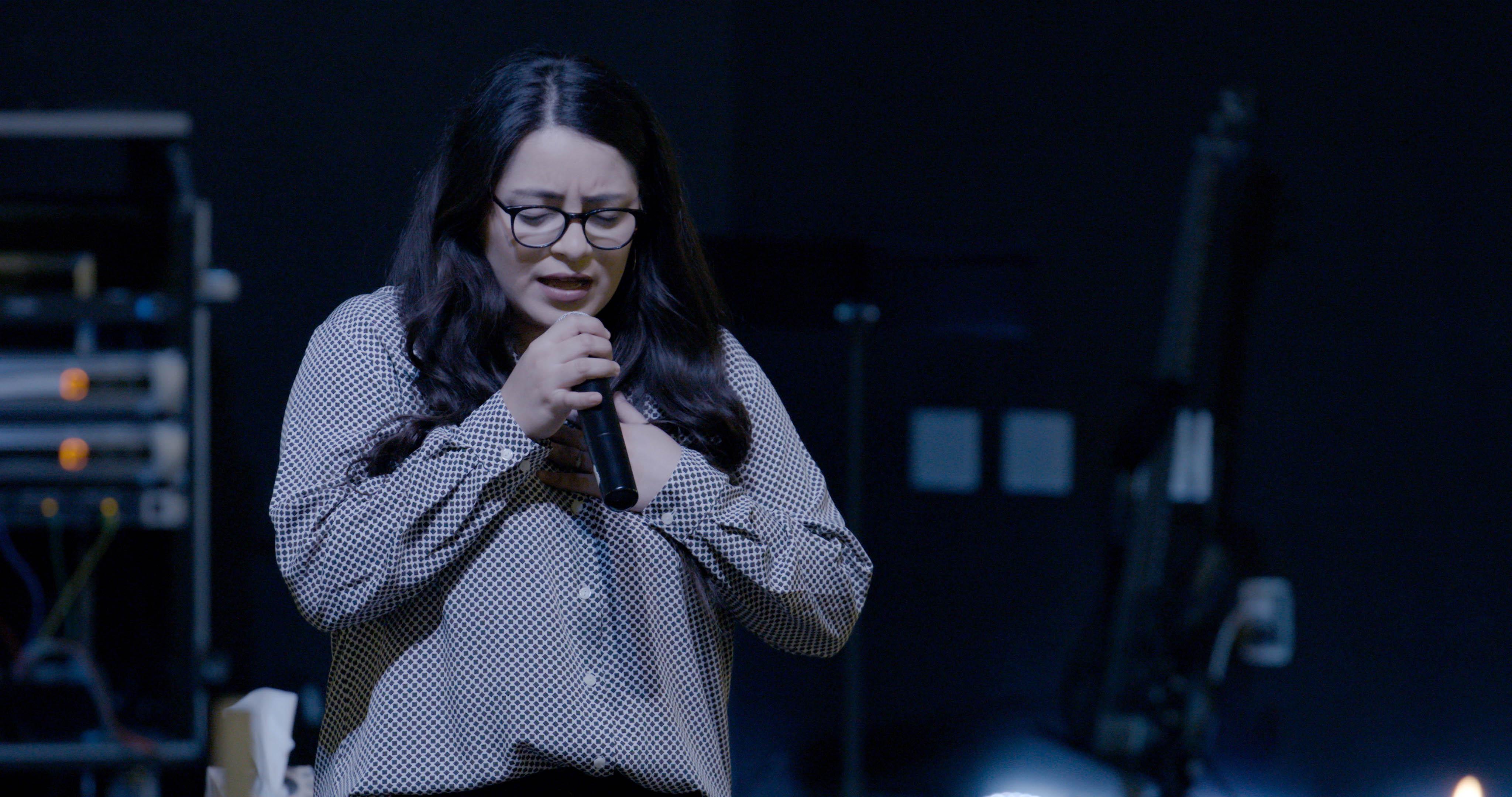 Female Vocalist Prays_HandHeart